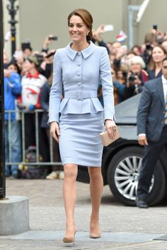 The Duchess wears a powder blue peplum jacket and skirt by Catherine Walker, nude suede pumps and a nude box clutch while visiting the Mauritshuis art gallery in the Netherlands. This marks her first time traveling solo, without the company of the royal family or her husband Prince William.