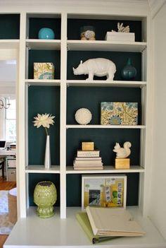 White bookcase with a dark inside.