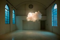 "The trick is to get the right level of humidity, temperature and lighting for it to look as real as those outside. Berndnaut shapes the cloud by using a fog machine. The surreal creation dissipates in a matter of moments, though, and the guy admits that a photograph is then the only ""document"" of its existence."
