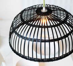 Close-up of a black pendant lamp shade made of bamboo.