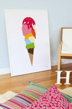 A boring corner of a room is updated in a sec with the help of some cushions and brightly coloured scoops of ice cream. Choose a simple white frame to make the colours really stand out. This print is by Showler & Showler.