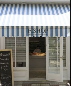 Like the way this fish shop has been decorated in a happy and friendly way. #commercial #awning