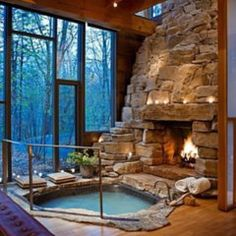 Dream home… indoor hot tub RIGHT NEXT TO the fireplace! Can it get any better? I suggest that it cannot!