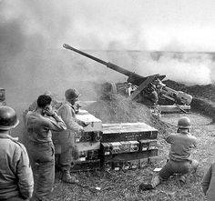 Americans soldiers fire from a captured German 88-mm anti-tank gun PaK 43/41. It was one of the most powerful anti-tank guns of World War II.