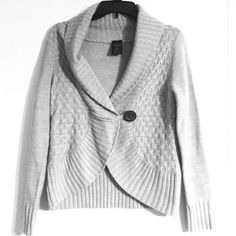 ❄️Gray wrap cardigan with wooden button Size small This gray sweater can be dressed up for work or dressed down for a cozy weekend. It features a fold over wrap with a wooden button in the center. Only worn a few times. True to size small.  Make an offer or add to a bundle for 20% off! ❄️Eligible for Winter Clearance!❄️BOGO 50% off! Buy 2, get 1 FREE! All sweaters, jackets, cardigans, and tights marked with a snowflake. ❄️ Sweaters Cardigans