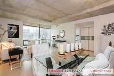 Open concept of Downtown Toronto condo, staged to sell for a high ROI via Toronto's home staging company, Design to Impress!