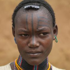 Tsemay tribe woman with tattoos on her face
