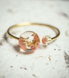 Gold Globe Resin Statement Cuff Sun Moon Bracelet Rose Yellow Gold Flakes Spere Orb Bangle OOAK modern jewelry eco friendly r Jewelry Logo, Resin Jewelry, Cute Jewelry, Modern Jewelry, Jewelry Accessories, Jewlery, Jewelry Shop, Jewelry Ideas, Gold Jewelry