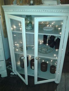 Shabby Chic Linen Cabinet. White exterior, sea green interior, glass doors. http://www.facebook.com/2ndEssence