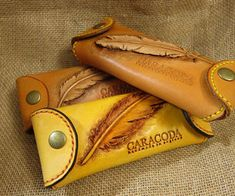 Eyeglasses leather case with feather