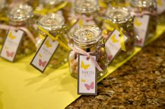 mini jars with white mint balls? @Jamie Pliscofsky Miller in italy they do something called Bomboniere which are party favors given out at special occasions usually filled with Jordan Almonds and usually is for good luck. this could be a cute idea for your baby shower because its so mini!<3