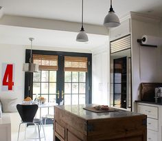 Love the black door with bamboo shades.