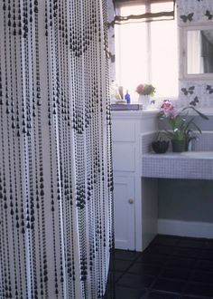 Shower Curtain DIYs to Revamp Your Bathroom  beaded curtain against a reg plastic one.  cool!