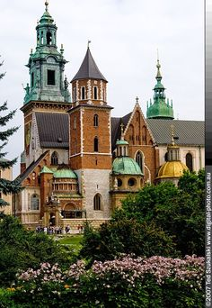 The Gothic Wawel Castle in Kraków in Poland was built at the behest of Casimir III the Great, who reigned from 1333 to 1370, and consists of a number of structures situated around the central courtyard. In the 14th century it was rebuilt by Jogaila and Jadwiga of Poland.