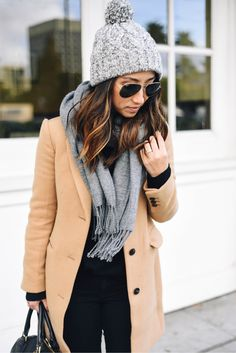 Grey beanie with pom pom + grey scarf with fringe + camel coat + black jeans and tshirt = geek chic outfit . use dark shades for a dramatic look!