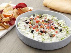 Greek Salad Layered Dip : Layer fresh Greek salad toppings over a cool yogurt dip with sweet cucumber and creamy feta cheese for a refreshing, lighter-tasting option at parties.