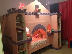 Wood bunk beds transformed into a castle with pink paint, mdf & crown molding and target shelving units.