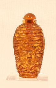 Antique Chinese amber snuff bottle with a Dragon over basket weave