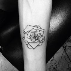 Geometric rose tattoo