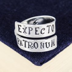 """Inspired by Harry Potter, this """"Expecto Patronum"""" aluminum wrap ring is hand stamped with care, one letter at a time. The rings are made out of Pure 1100 Aluminum, which is food safe and does not tarn"""
