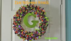 Love how she added the monogram in the middle!  // Easy Halloween Decorations: Fabric Strip Wreath