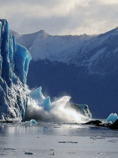 Huge pieces of ice from Perito Moreno glacier falling into the lake, Patagonia, Argentina