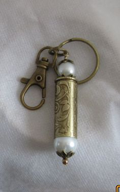 Etched 45 Colt Cartridge keychain w/pearl and purse attachment by Dorothy Brunner  - featured on Jewelry Making Journal
