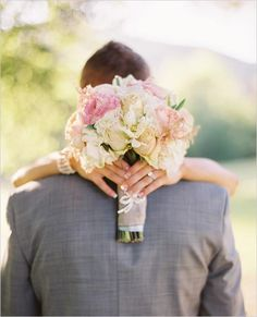 I like the picture idea. But the way the flowers are tied is cute too!