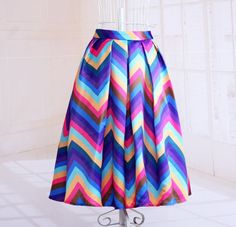Be charming and gorgeous as you pair this with any top. This skirt features rainbow stripe pattern, gorgeously flared with pleated details, elastic back. Crafted from polyester and spandex materials.
