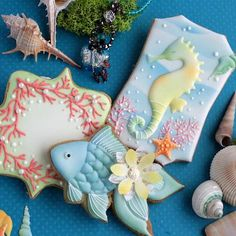 Coral, sea horse, fan-tail fish, beautiful air-brushed colors artfully created cookie set by La Cachette, posted on Cookie Connection Summer Cookies, Fancy Cookies, Iced Cookies, Cute Cookies, Royal Icing Cookies, Cupcake Cookies, Fish Cookies, Basic Cookies, Bolacha Cookies