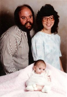 And the photographer thought that it would be hard to get the baby to smile. (submitted by Andrea)