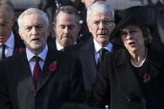 Theresa May Photos Photos - (Front L-R) Labour Leader Jeremy Corbyn and British Prime Minister Theresa May sing the national anthem during the annual Remembrance Sunday Service at the Cenotaph on Whitehall on November 13, 2016 in London, England. The Queen, senior politicians, including the British Prime Minister and representatives from the armed forces pay tribute to those who have suffered or died at war. - The Royal Family Lay Wreaths at the Cenotaph on Remembrance Sunday