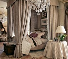 formal ralph lauren bedroom with high end lace lined fabric draping all around