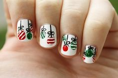 Even if you have short nails you can still don a perfectly cute Christmas nail art design. Check out this Christmas balls designs where you use white polish and a combination of black, green and red polishes for the ball details. Glitter polish is also used for effect.