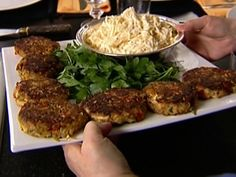 I never follow a recipe, but this is where I start from for crab cakes!! Crab Cakes Recipe : Ina Garten : Food Network