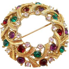 Vintage authentic Swarovski wreath brooch of textured gold tone accented with red, green, purple and crystal rhinestones...suitable for Christmas! It
