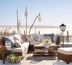 Love the use of driftwood to hang the lanterns ... I could live in this outdoor space!