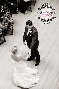 First dance.  Groom twirling bride.  Get a unique angle from above! Classic Southern Wedding at art gallery and historic home.   Photography:  Andie Freeman Photography www.TheAthensWeddingPhotographer.com Event Coordinator: www.WildflowerEventServices.com Event design and Catering:  Mama's Boy Venue:  Lyndon House Arts Center