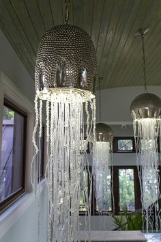 Located in Marathon, Florida, the amazing dream home was a huge remodel and expansion project by D'Asign Source, a turnkey design/build firm in the Florida Keys. Home Lighting, Chandelier Lighting, Chandeliers, Crochet Feathers Free Pattern, Jellyfish Light, House Of Turquoise, Favorite Paint Colors, Sell Your House Fast, Sun And Water