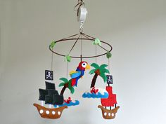 Upgrade your mobile into a rotating musical mobile -musical mobile - music box - not sold separately. $24.50, via Etsy.