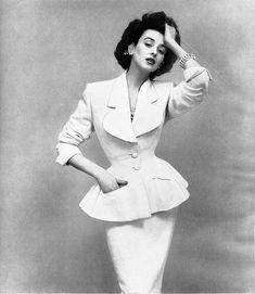 Dorian Leigh in Lilli Ann suit, Harper's Bazaar, May 1952