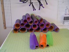 "Halloween wreath using a Black Pencil wreath, three colors of 10"" Deco Poly Mesh. Tutorial demonstrates the ruffle technique, adding ribbons and embellishments. See more images and instructions on the Trendy Tree Blog http://www.trendytree.com/blog/halloween-ruffle-wreath-tutorial-using-deco-poly-mesh-and-raz-halloween-decorations/"