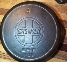 """The oldest of the """"good metal"""" was the slant ERIE logo. The word GRISWOLD slanted slightly to the right."""