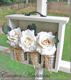 Repurposed drawer, soup cans and flowers