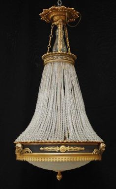 I just discovered this REGENCY DESIGN BRONZE CHANDELIER on LiveAuctioneers and wanted to share it with you: www.liveauctioneers.com/item/40483659