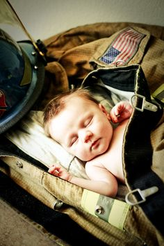A photo in her Daddy's  turnout gear.