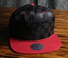 3c8fac4d5c5 Chicago Bulls Mitchell   Ness Upfield Snapback Checkered Polyester Contrast  team color visor with visor rope Raised embroidered front logo Snap closure  ...