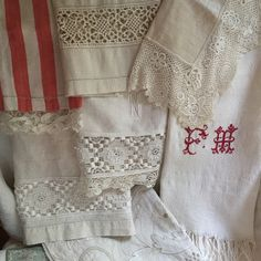 a collection of antique and restored hand towels in linen & lace