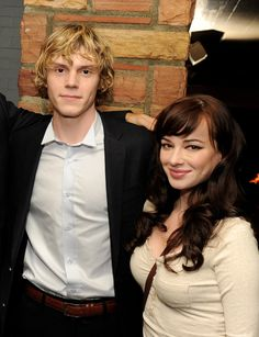 """Evan Peters Photos - Actors Evan Peters (L) and Ashley Rickards pose at the after party for FX Network's """"American Horror Story"""" at the Hollywood Roosevelt Hotel on October 3, 2011 in Los Angeles, California. - Premiere Of FX's """"American Horror Story"""" - After Party"""