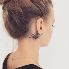 60  Cute Summer Tattoo Art Design Ideas For Woman:Minimal Swallow Head Tattoo Behind Ear